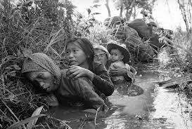 Unarmed Vietnamese Hide from US My Lai Assault