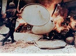 Vietnam My Lai torching a home