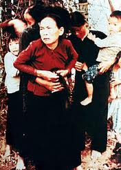 Vietnam Women and children huddled by tree at My Lai