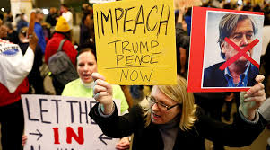impeach-trump-posters-at-rally